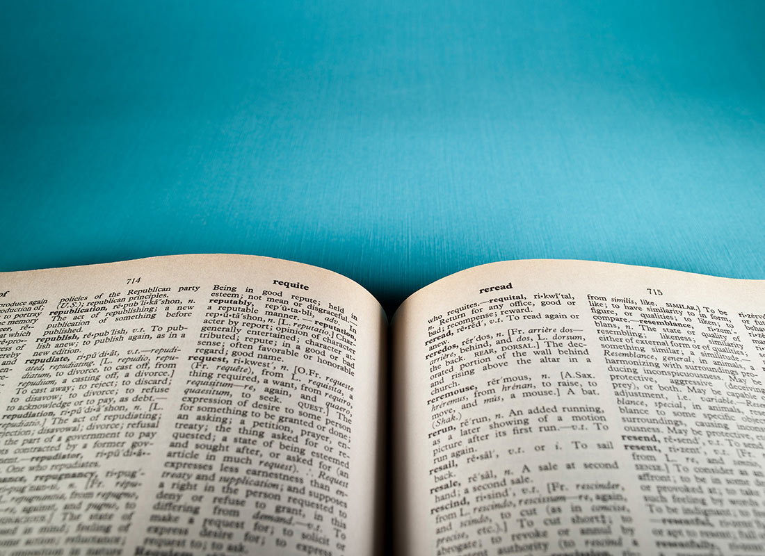 A cropped image of an open dictionary