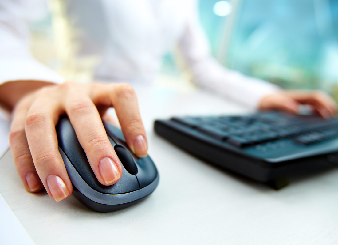 A hand resting comfortably on a computer mouse