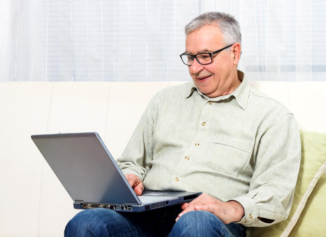 a man relaxing with his laptop computer