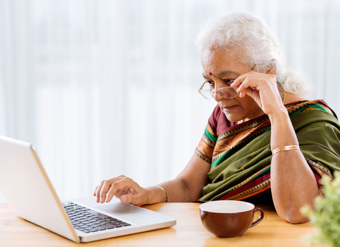 a lady reading emails on her laptop