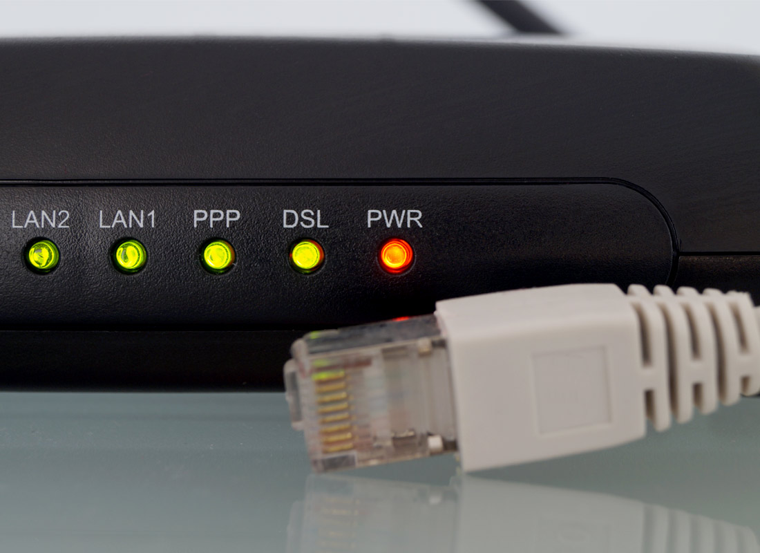 Lights are on and the cable is ready to be plugged in from a home internet router device