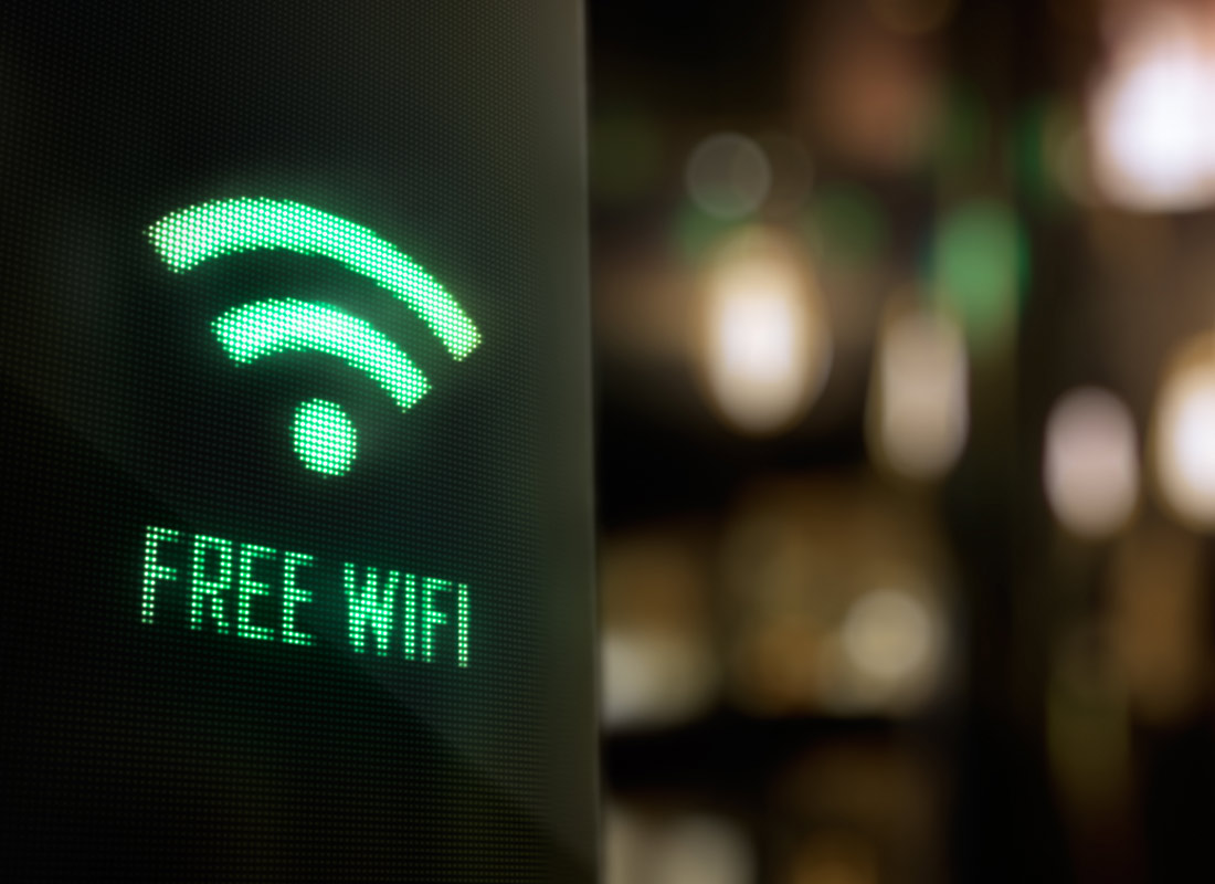 A lit up sign explains that there is free wifi available