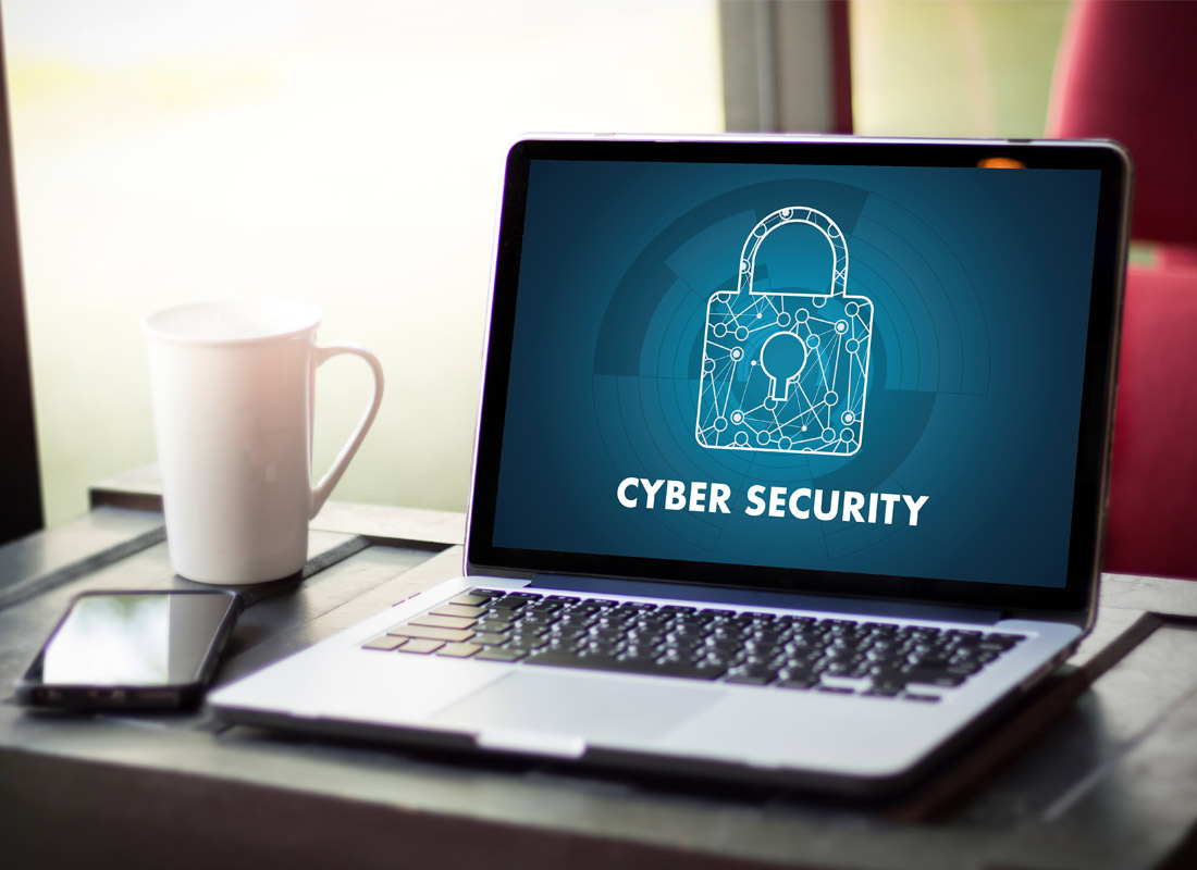 A laptops shows a screen with a padlock on it saying cyber security