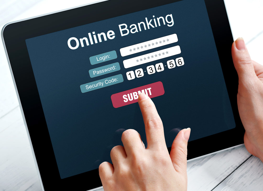 A tablet is used to submit details to access online banking
