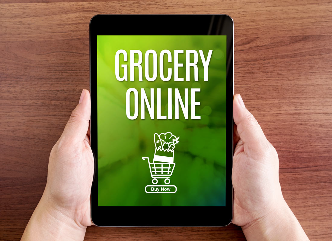 A handheld device shows the ability to do grocery shopping at the touch of a finger