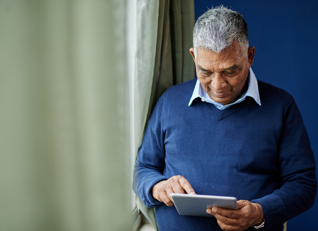 A man proudly and independently uses his tablet