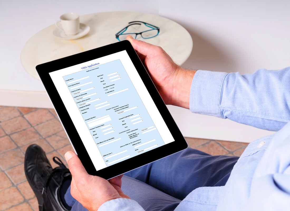 A man looks at an online form on his tablet