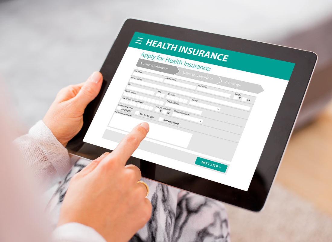 Someone is using a tablet to complete a health insurance form online