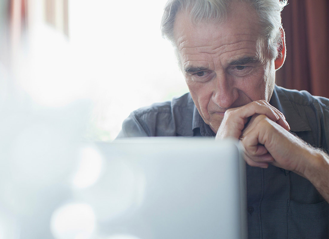 A man concentrates on his computer screen