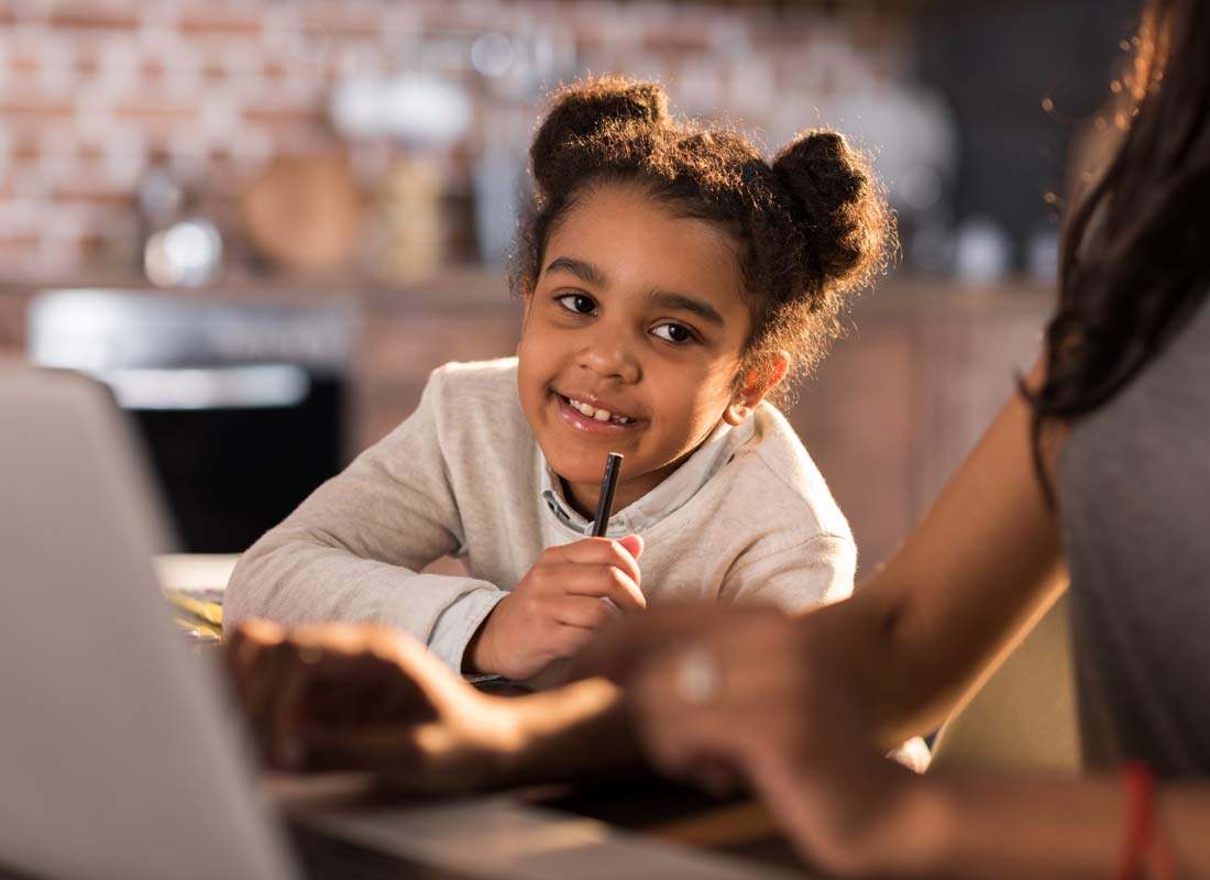 A happy child learns about technology