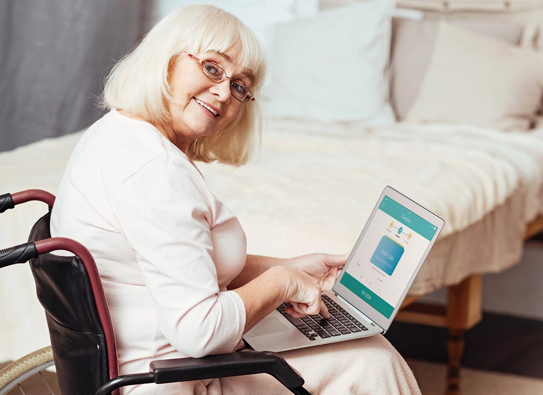 Mary enjoying connecting to her family on the laptop