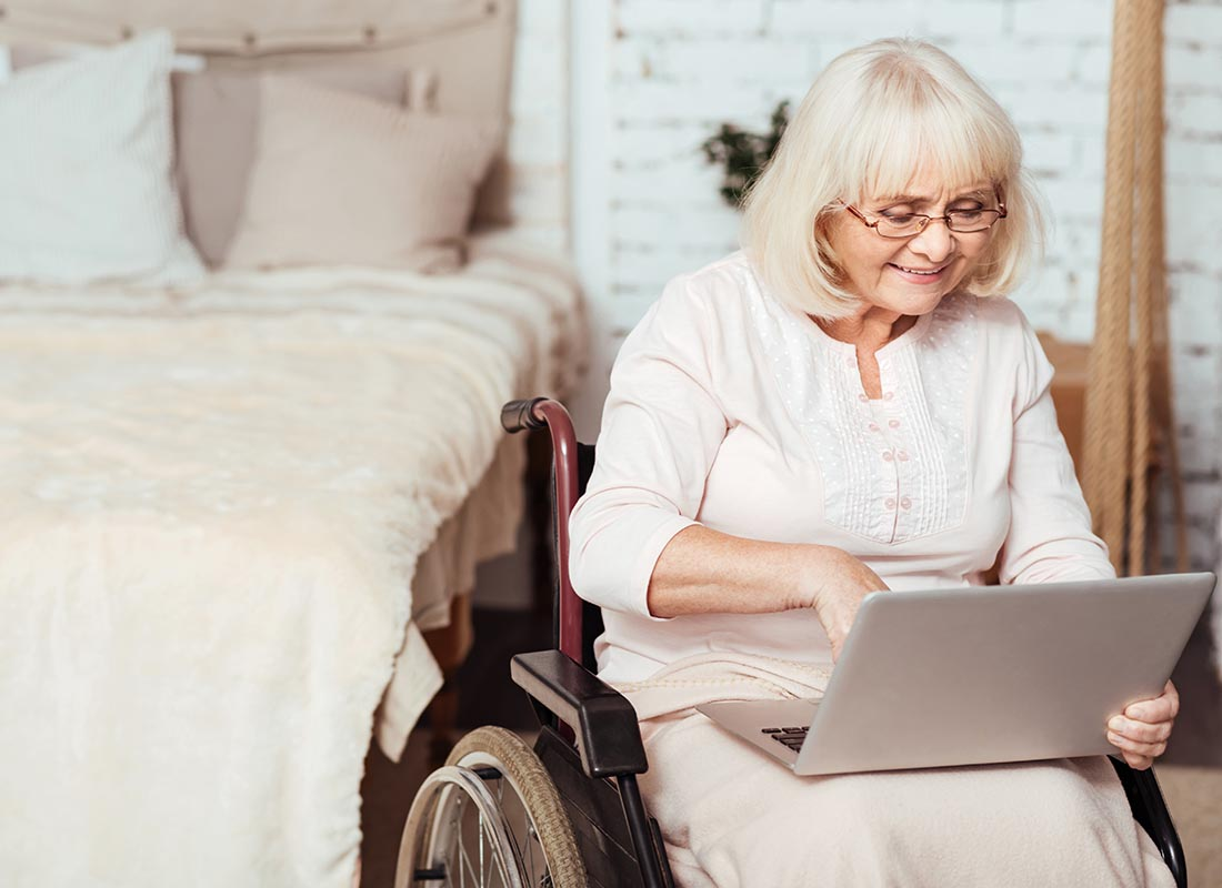 Mary connecting to others using her laptop