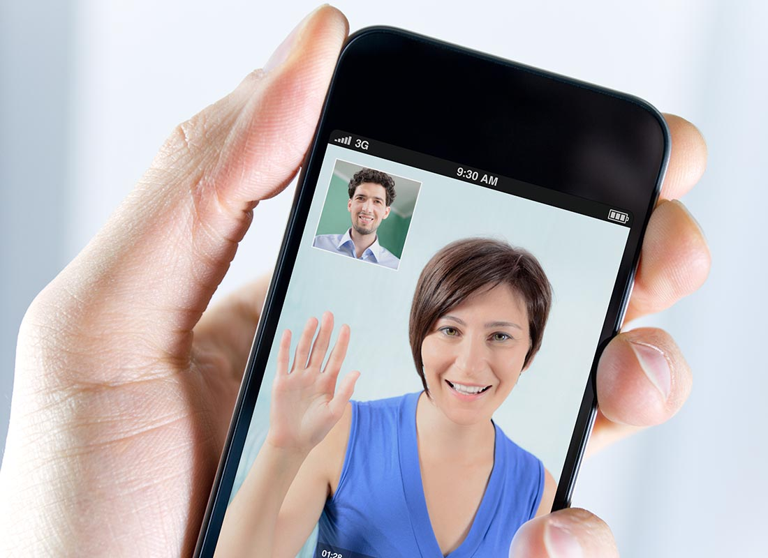 Two people catching up on Skype on a mobile phone
