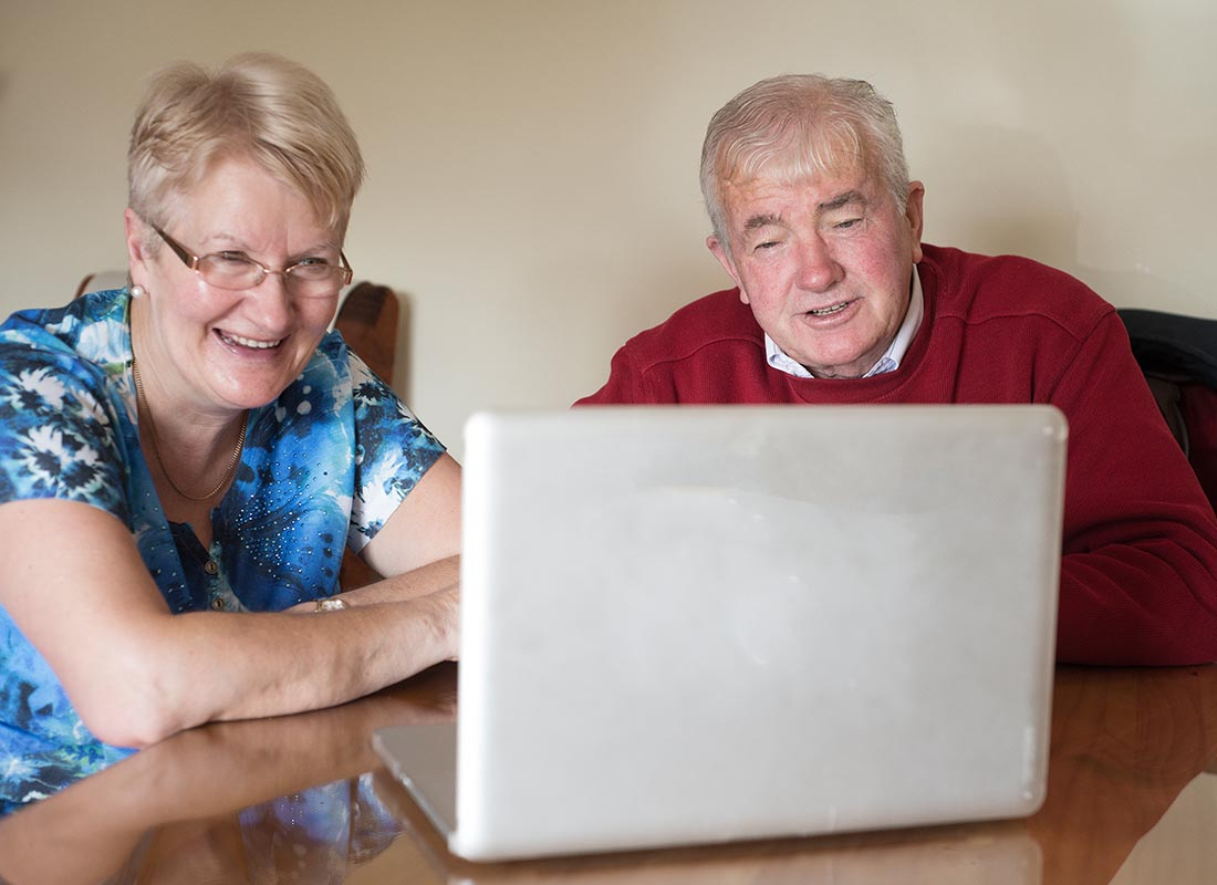 A couple enjoying video chatting to their family
