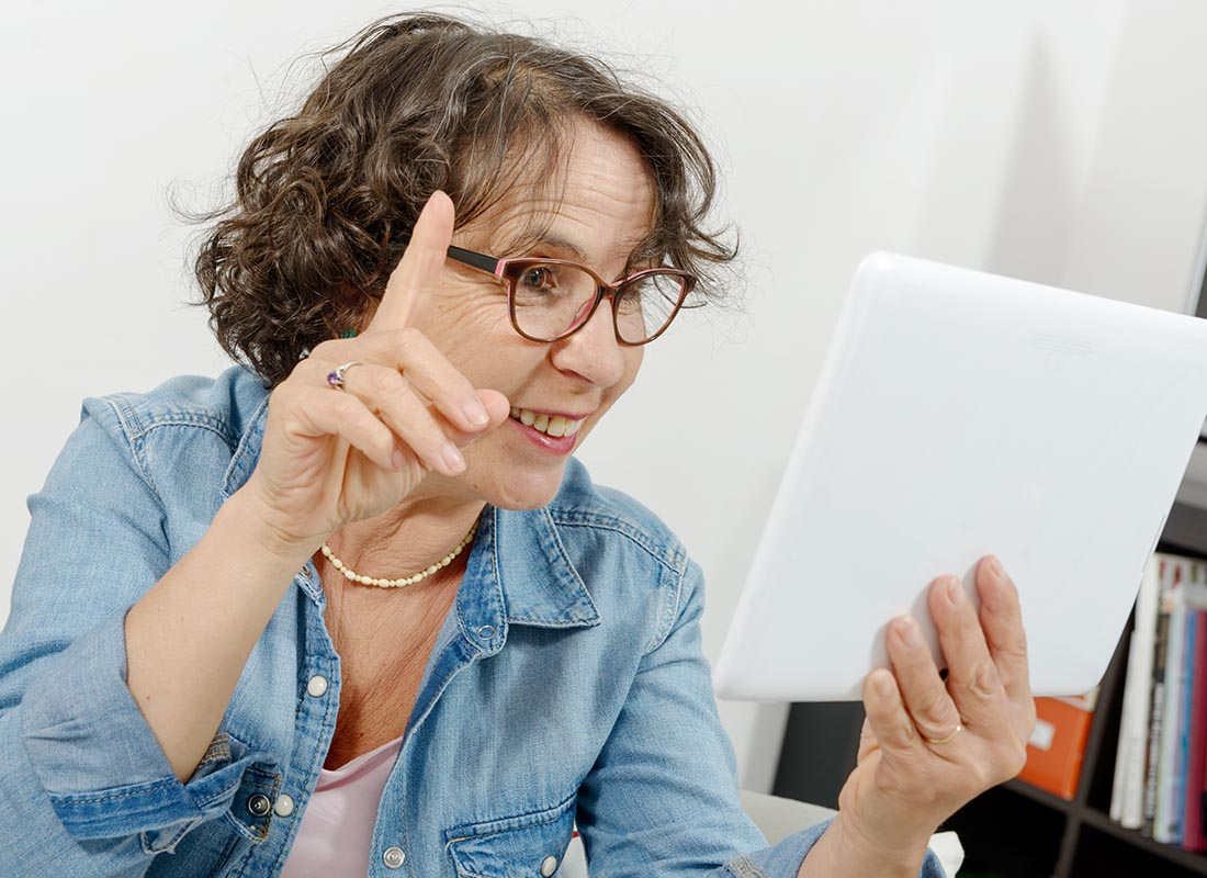 A lady joining in a video chat using her tablet device