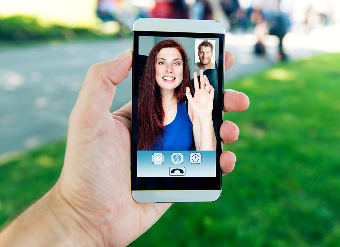 A mobile phone screen showing two people video chatting