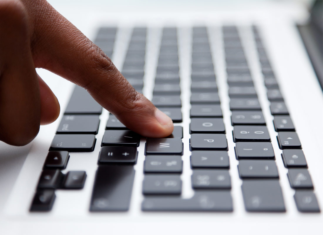 A close up of a hand typing on a keyboard