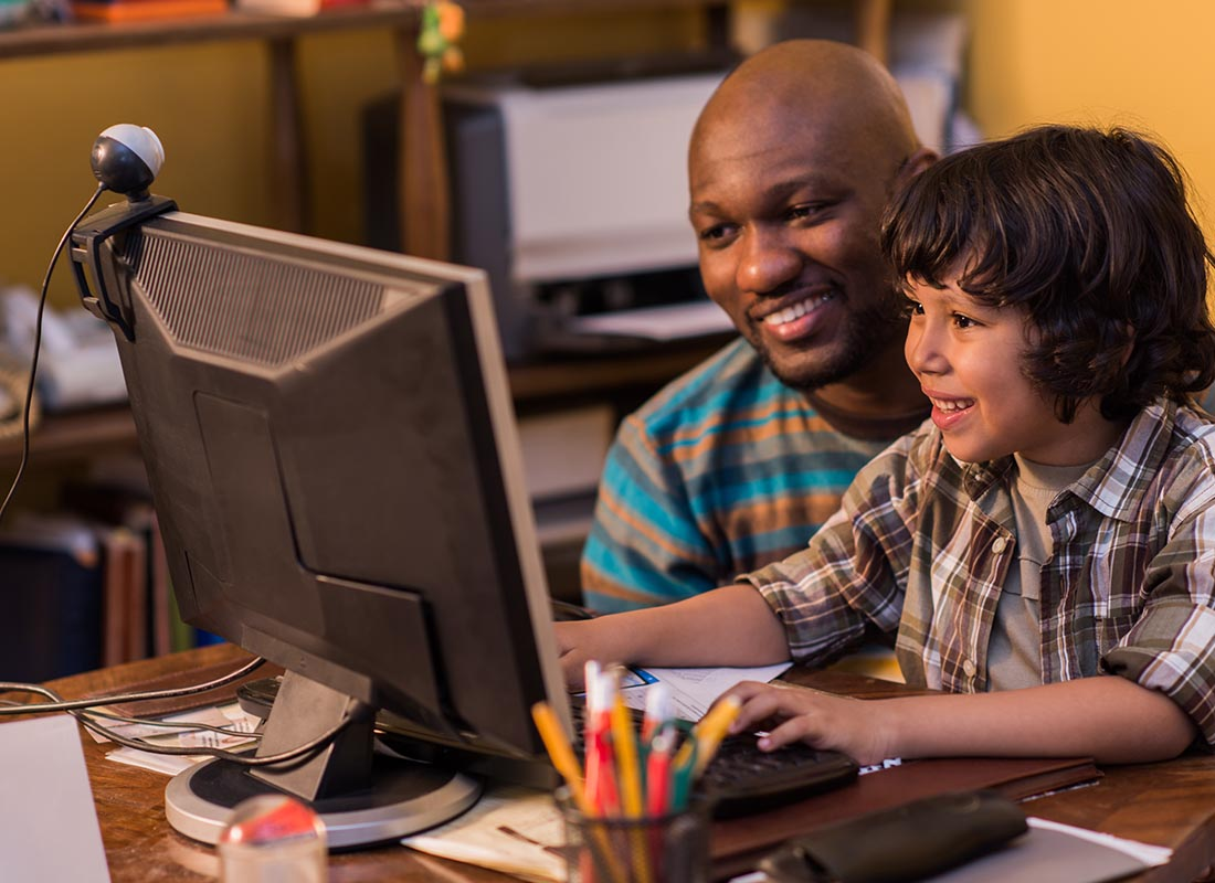 A father and child enjoying using a computer together