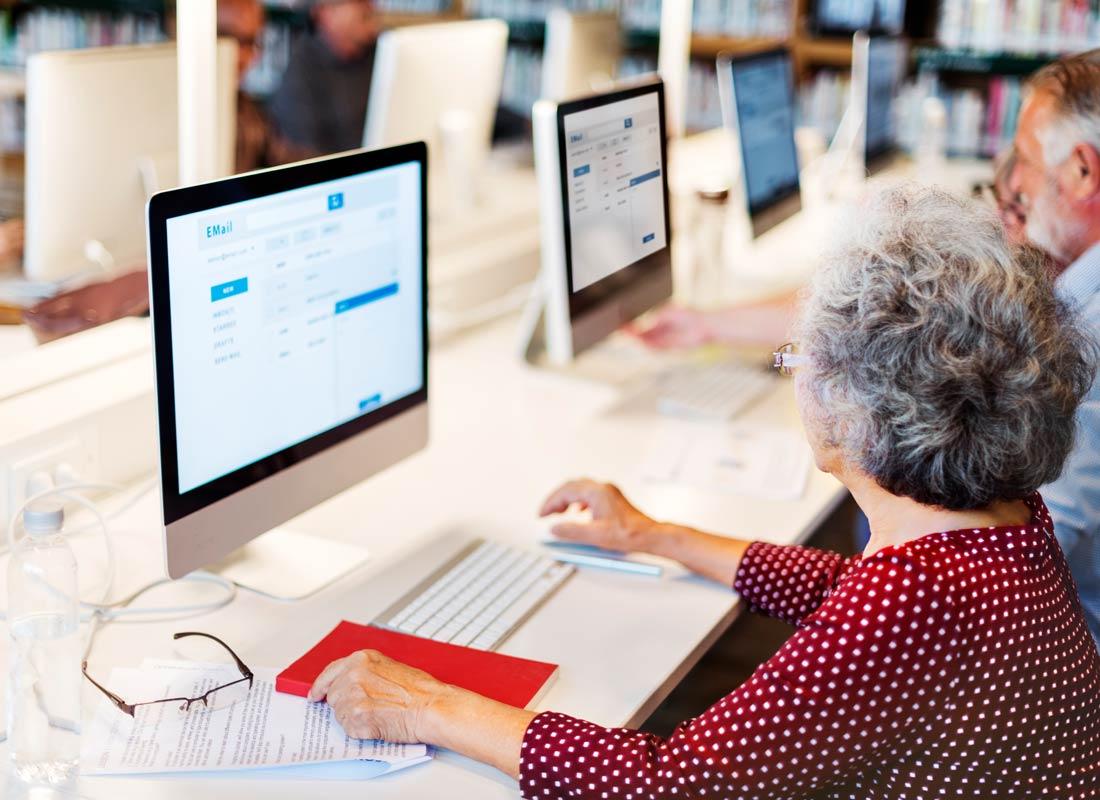 Some tech savvy older Australians working on their desktop computers