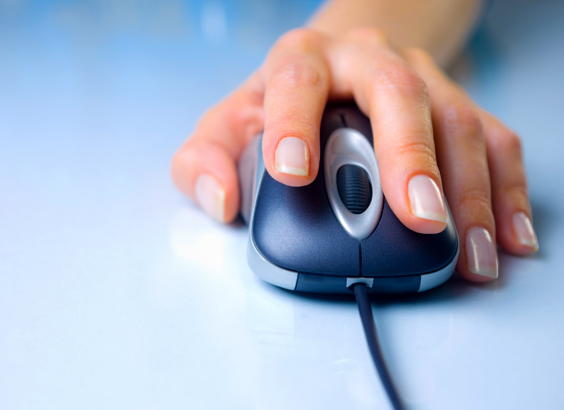 A close up of a hand on a computer mouse