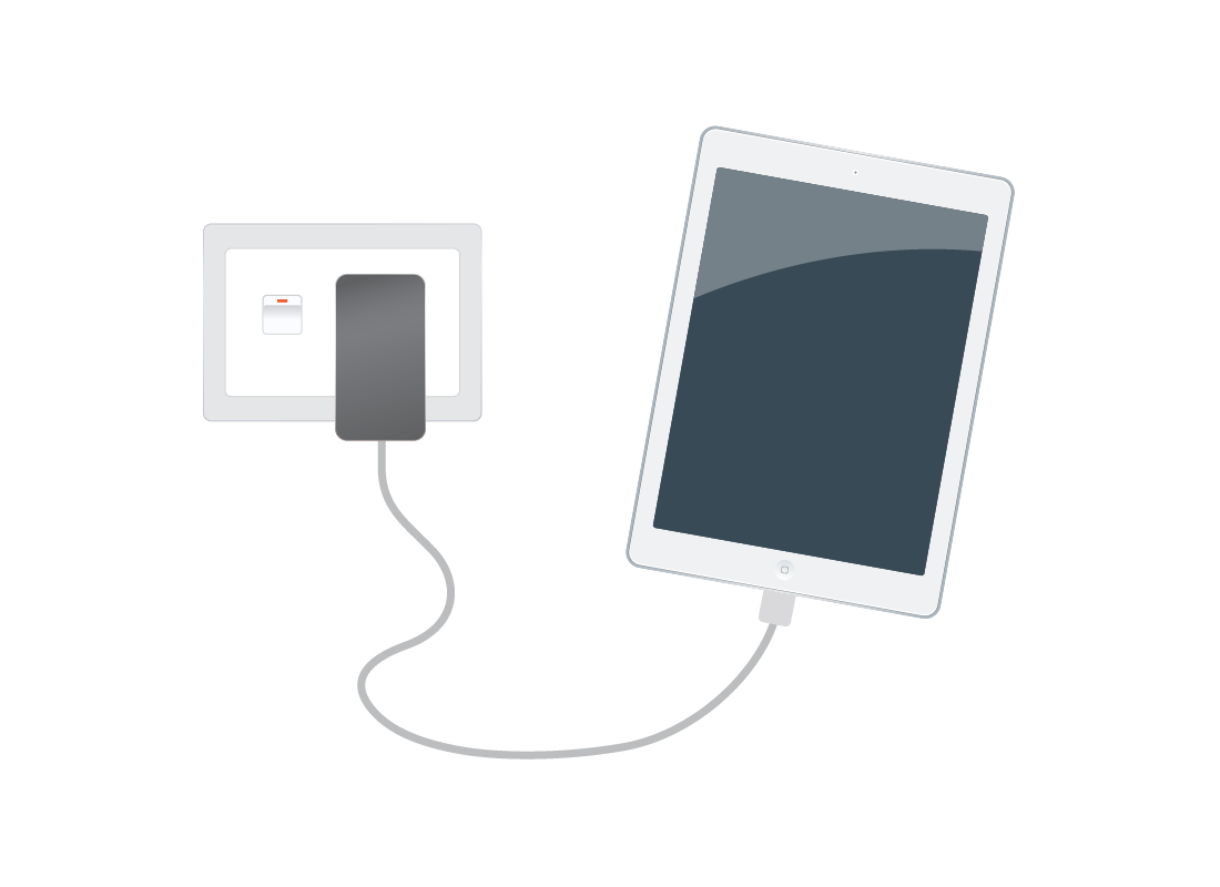 A tablet plugged into the mains power to recharge the battery