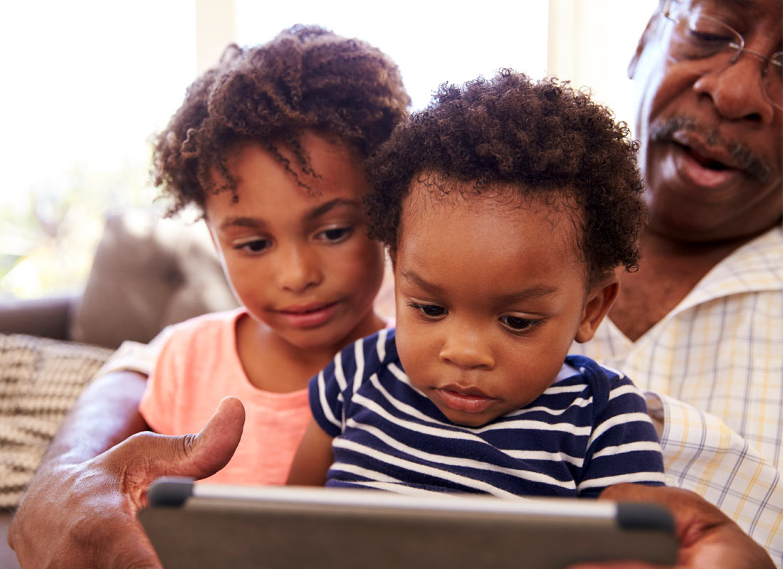 A family sharing a learning activity on their tablet