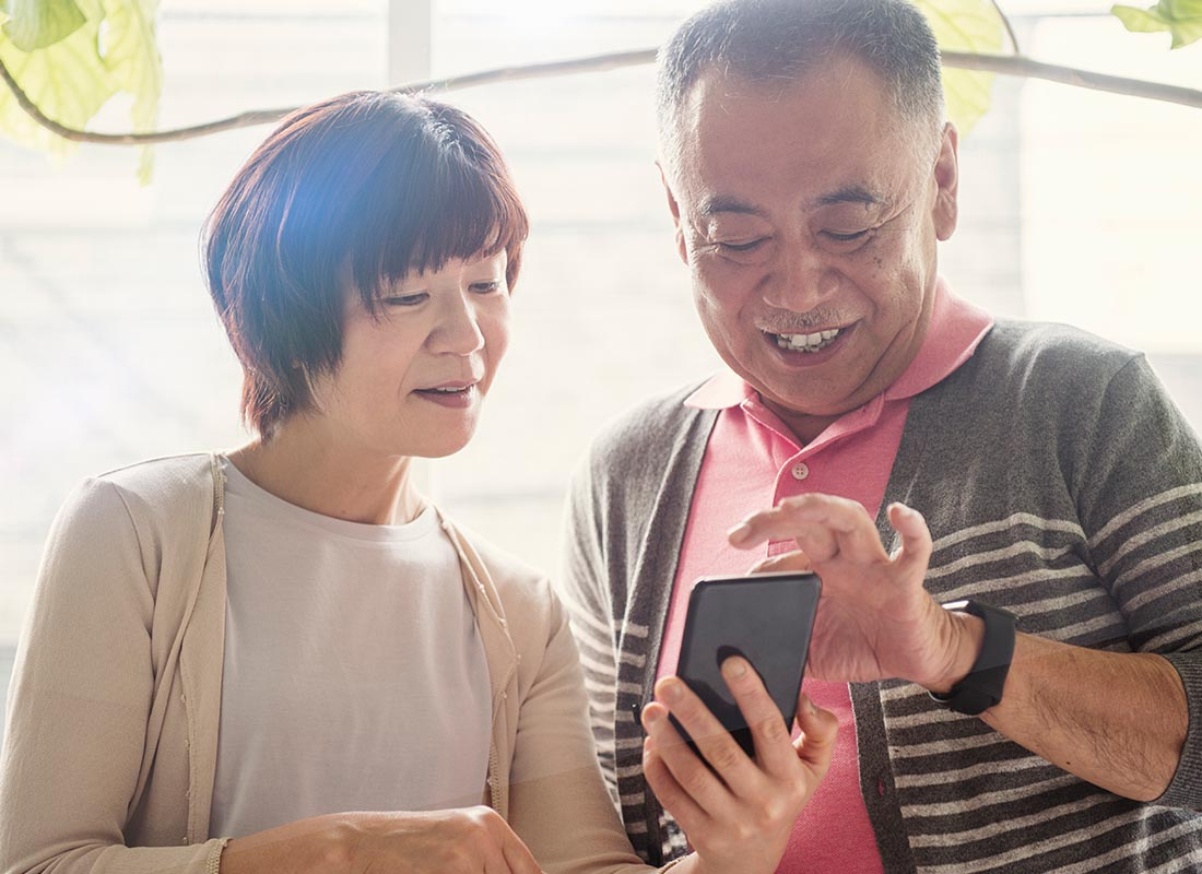 A couple using their charged up smartphone