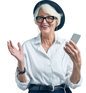 A smiling 70-year-old woman with a pork-pie hat and dark-rimmed glasses enjoying listing to a podcast on her mobile phone with earphones.