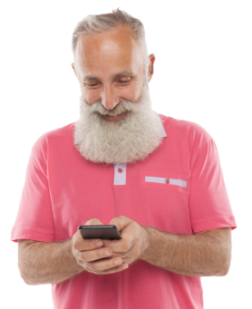 A happy 60-year-old man engaged in playing a game on his mobile phone.