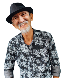 A confident and friendly older Asian man wearing a Hawaiian shirt and black hat.