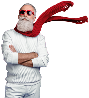 Heroric grey bearded man in sixties stands proudly in red sunglasses and a red scarf.