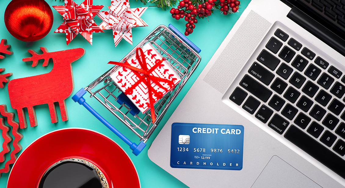 Christmas decorations next to a laptop and credit card