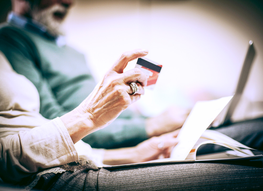 Checking credit card payments on an online bank account from home before making a purchase