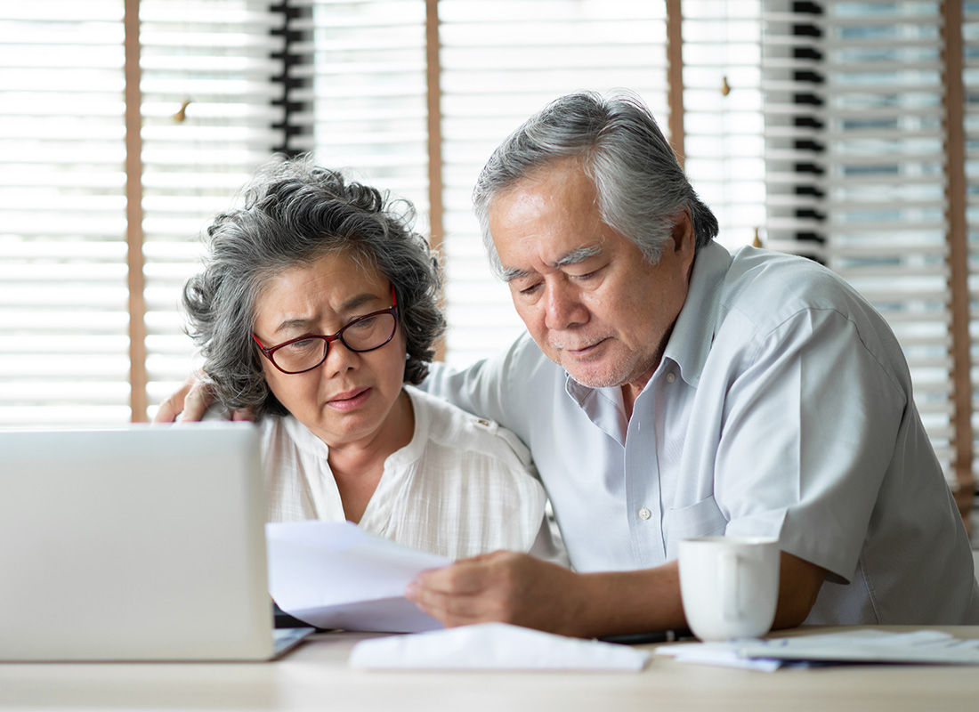 A couple check their bills ready to pay them online