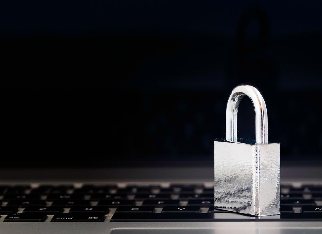 An image of a padlock and a computer keyboard