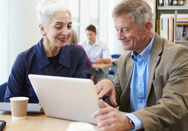 Woman and man sharing laptop