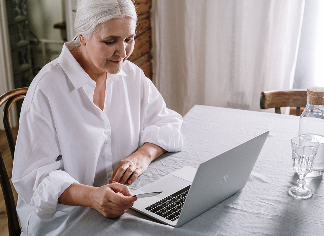 A lady checking her online account on her laptop computer