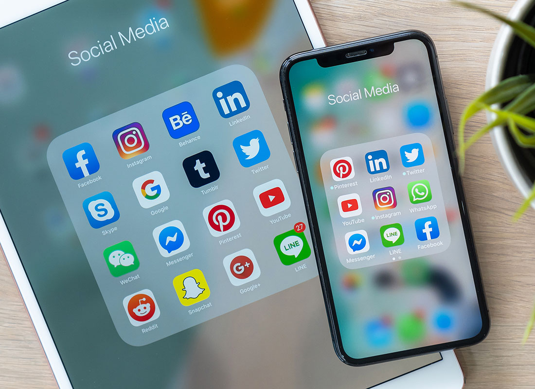 A close up of smart device screens showing many different social media app icons
