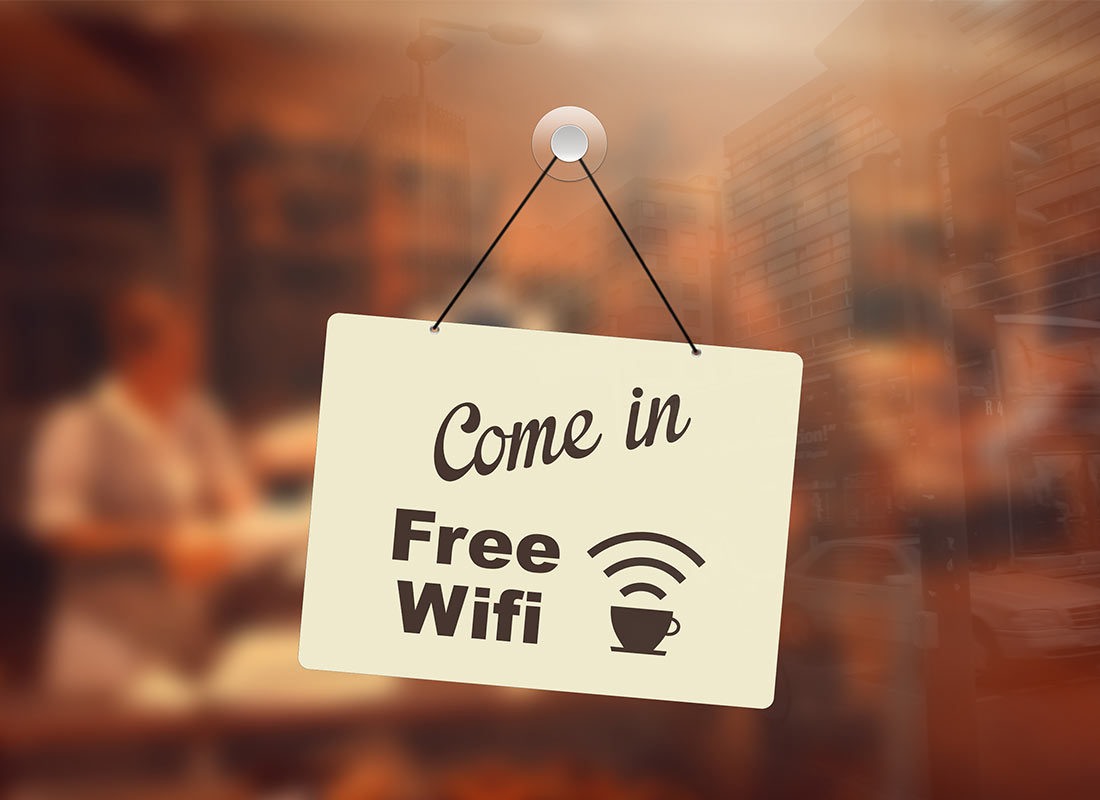 A welcoming sign at a cafe offering free Wi-Fi