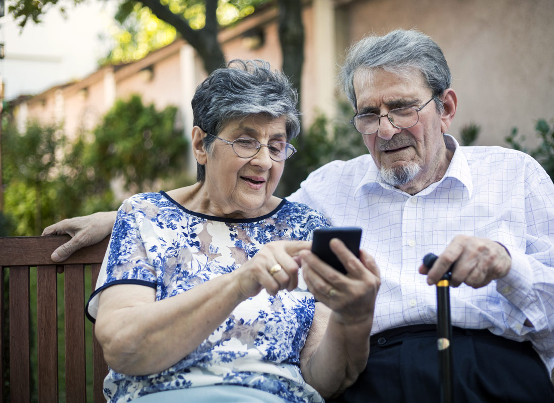 A couple checking the bus timetable using an app on their smartphone