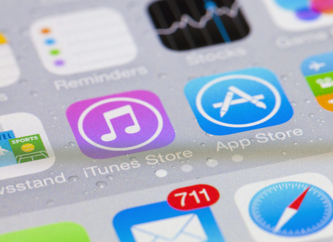 The iTunes and App Store app icons on an iPhone screen