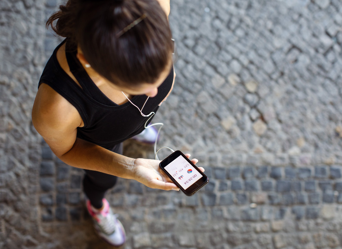 A jogger checking her heart rate on her smartphone's health app