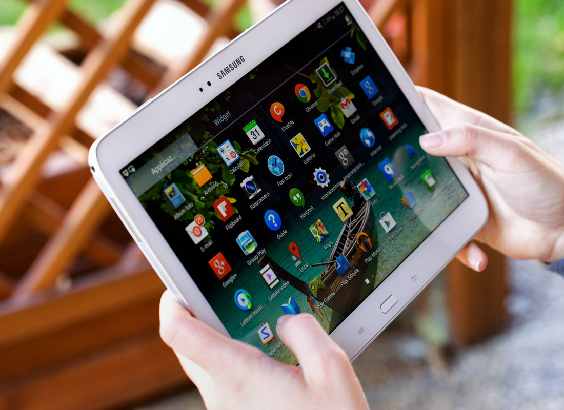 A tablet device with an array of apps on the screen