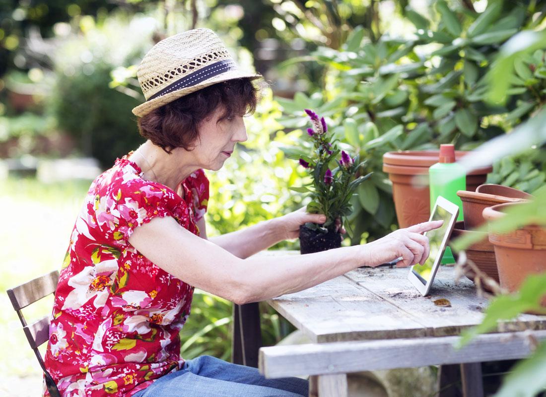 A keen gardener reading her favourite gardening blog