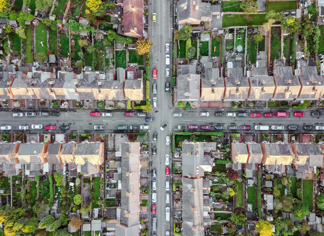 An aerial photo of a suburban street cross section. The photo may have been taken from a drone as it's looking directly down to the ground.