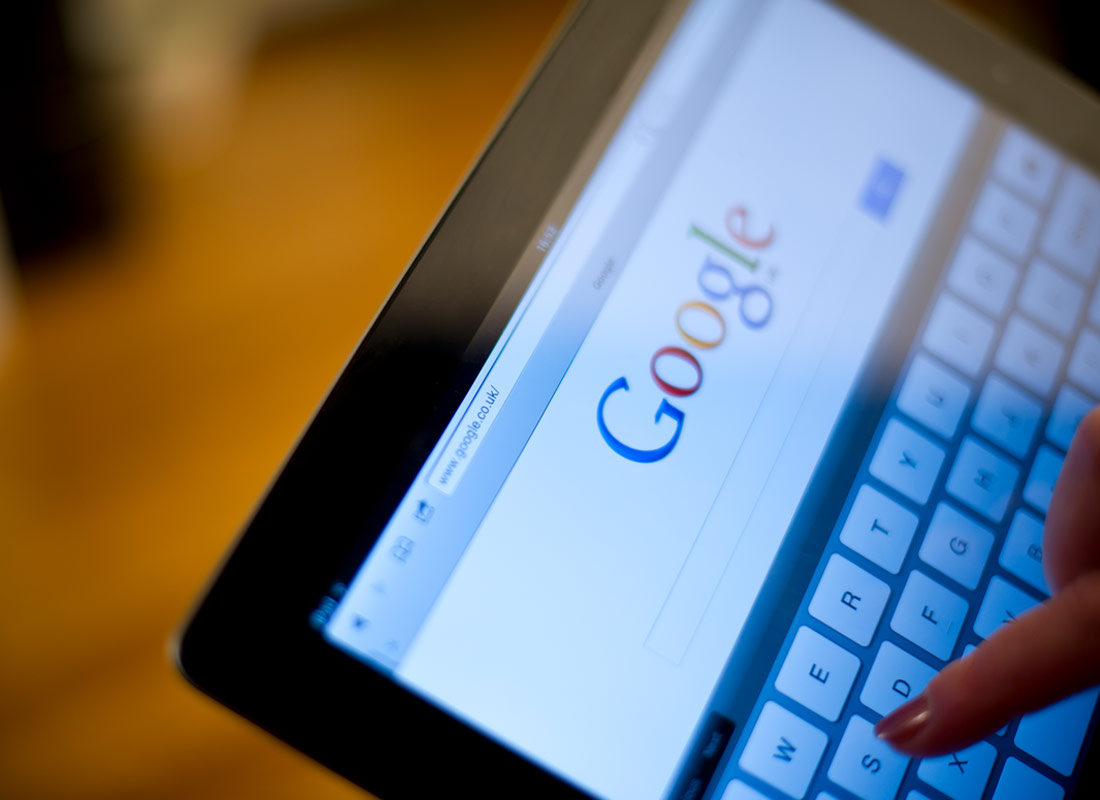 A photo of a tablet with Google's Chrome browser open and someone is about to search for something.