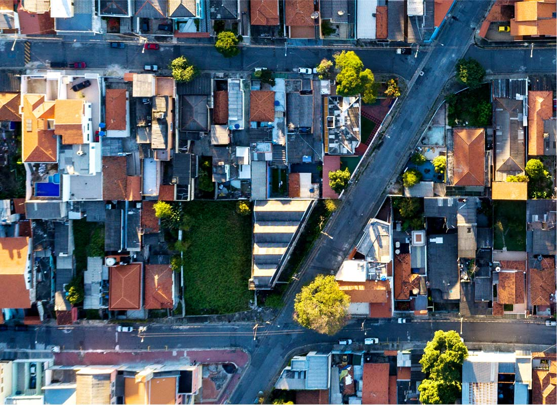 An overhead shot of a town's streets and buildings