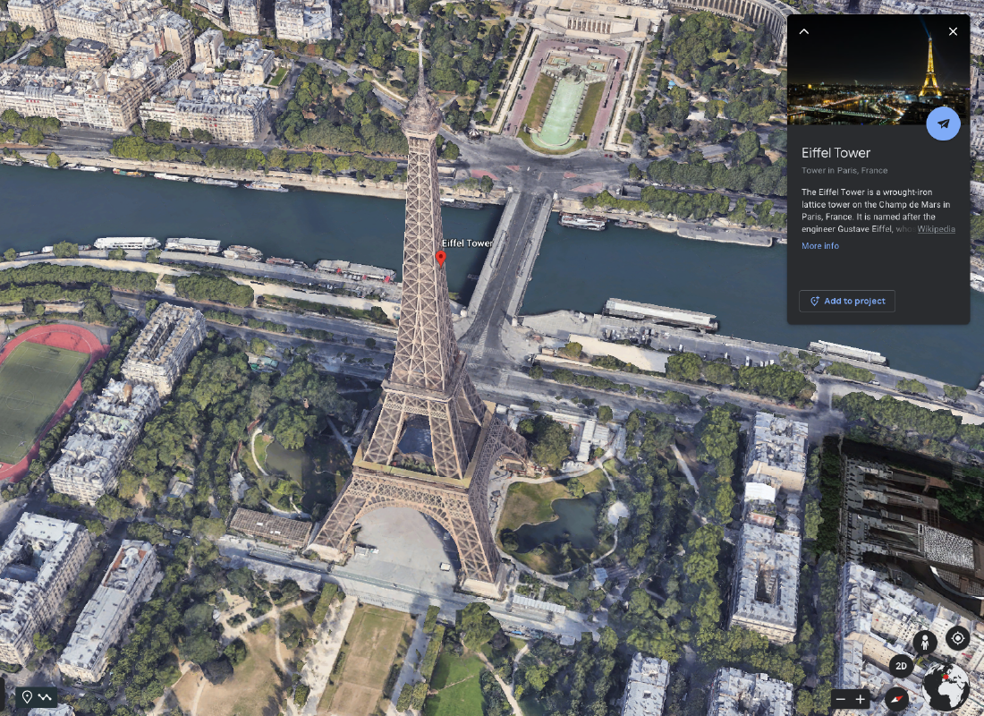 A screenshot of Google Earth showing the Eiffel Tower in 3D.