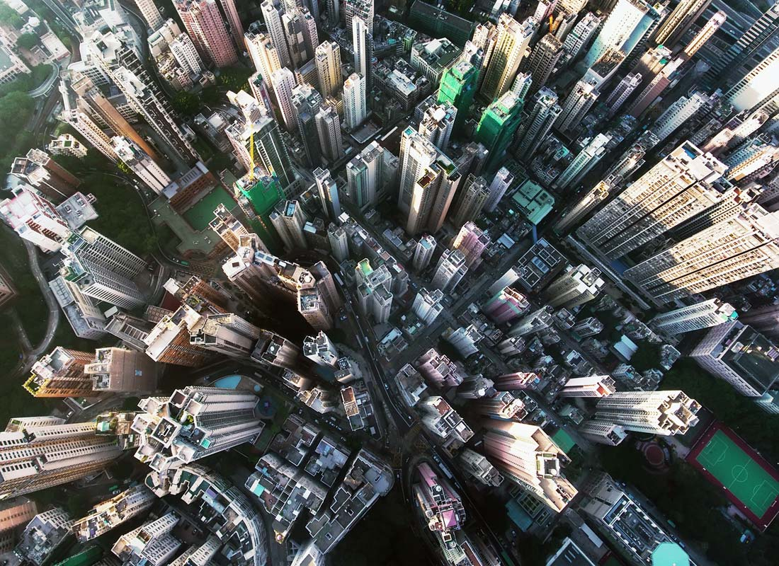 An aerial photograph of skyscrapers in a city, as you might see on Google Earth.